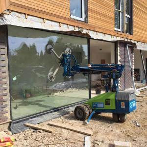 Using a glass robot to install a large piece of glass